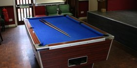 The Club has a pool table, dart boards, and cards available.